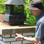 Cracks in a chimney cap require repair to prevent water infiltration